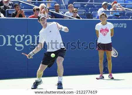 NEW YORK - AUGUST 19: Grand Slam Champion Andy Murray practices with his coach Amelie Mauresmo for US Open 2014 at Billie Jean King National Tennis Center on August 19 , 2014 in New York  - stock photo