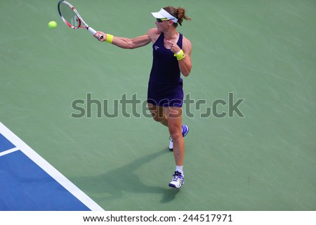 NEW YORK - AUGUST 26, 2014:  Grand Slam Champion Samantha Stosur from Australia during US Open 2014 first round match against Lauren Davis at Billie Jean King National Tennis Center in New York  - stock photo