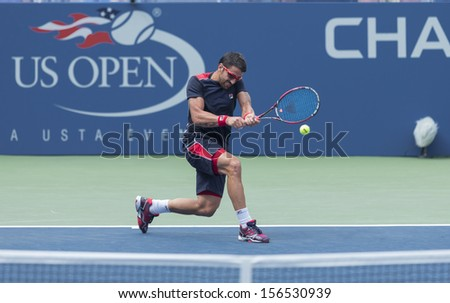 NEW YORK - AUGUST 31: Janko Tipsarevic of Serbia returns ball during 3rd round match against Jack Sock of USA at 2013 US Open at USTA Billie Jean King Tennis Center on August 31, 2013 in New York