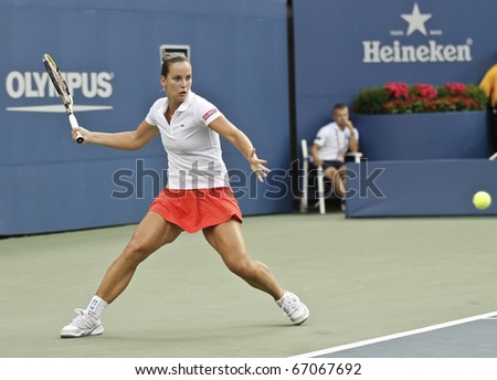 NEW YORK - AUGUST 31: Jarmila Groth of Australia returns ball during first round match against Maria Sharapova of Russia at US Open tennis tournament on August 31, 2010, New York. - stock photo