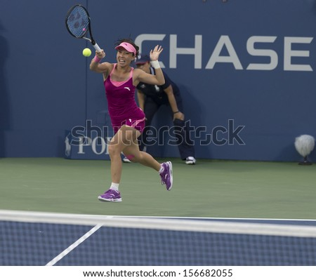 NEW YORK - AUGUST 28: Jie Zheng of China returns ball during 2nd round match against Venus Williams of USA at 2013 US Open at USTA Billie Jean King Tennis Center on August 28, 2013 in New York