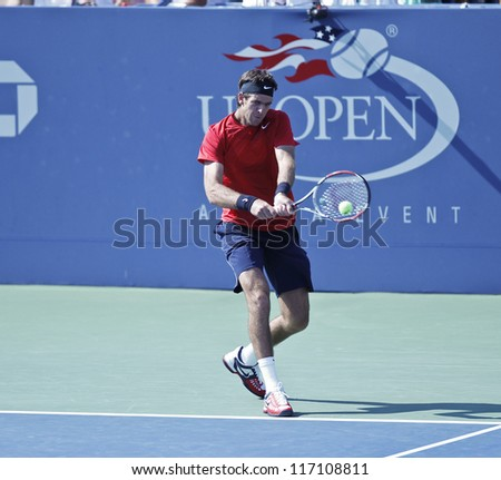 NEW YORK - AUGUST 31: Juan Martin Del Potro of Argentina returns ball during 2nd round match against Ryan Harrison of USA at US Open tennis tournament on August 31, 2012 in Flushing Meadows New York