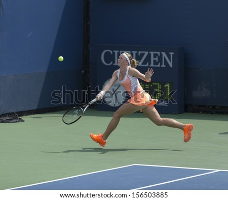 NEW YORK - AUGUST 31: Julia Glushko of Israel returns ball during 3rd round match against Daniela Hantuchova of Slovakia at 2013 US Open at USTA Billie Jean King Tennis Center on August 31 2013 in NYC - stock photo