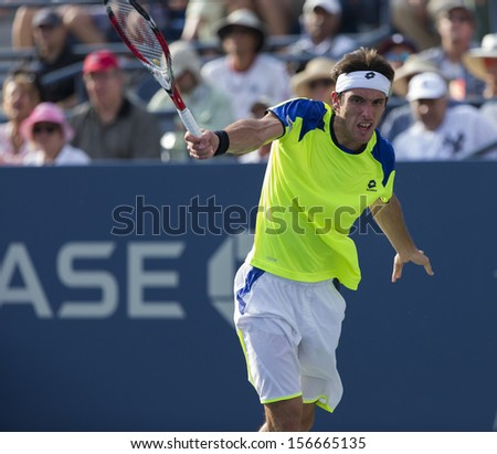 NEW YORK - AUGUST 30: Leonardo Mayer of Argentina returns ball during 2nd round match against Andy Murray of Great Britain at 2013 US Open at USTA Center on August 30, 2013 in New York - stock photo