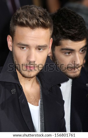 "NEW YORK - AUGUST 26:  Liam Payne and Zayn Malik of One Direction attend the premiere of ""One Direction This Is Us"" at the Ziegfeld Theater on August 26, 2013 in New York City. - stock photo"