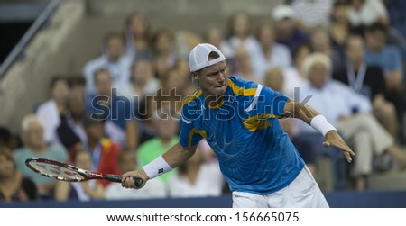 NEW YORK - AUGUST 30: Lleyton Hewitt of Australia returns ball during 2nd round match against Juan Martin Del Potro of Argentina at 2013 US Open at USTA Center on August 30, 2013 in New York