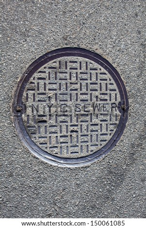 NEW YORK - AUGUST 6: manhole cover on August 6, 2013 in New York. New York City's water supply system is one of the most extensive municipal water systems in the world. - stock photo