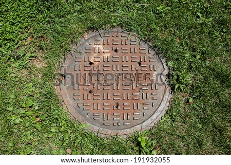 NEW YORK - AUGUST 2: manhole cover on August 2, 2013 in New York. New York City's water supply system is one of the most extensive municipal water systems in the world. - stock photo