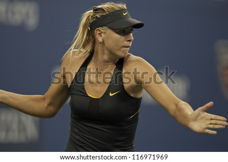 NEW YORK - AUGUST 29: Maria Sharapova of Russia returns ball during 2nd round match against Lourdes Dominguez Lino of Spain at US Open tennis tournament on Augist 29, 2012 in Flushing Meadows New York - stock photo