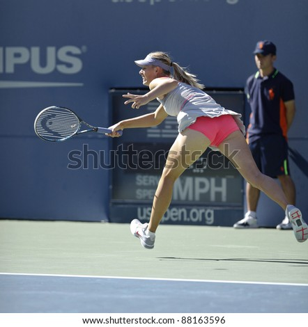 NEW YORK - AUGUST 29: Maria Sharapova of Russia returns ball during 1st round match against Heather Watson of United Kingdom at USTA Billie Jean King National Tennis Center on August 29, 2011 in NYC - stock photo