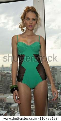 NEW YORK - AUGUST 21: Model wearing Rica Swimwear at the Rica Swimwear private preview for fashion week Spring/Summer 2013 on Rooftop at Mondrian Soho hotel in Manhattan on August 21, 2012 in NYC