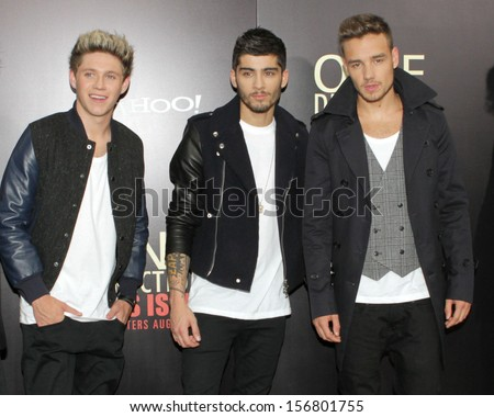 "NEW YORK - AUGUST 26: Niall Horan, Zayn Malik and Liam Payne of One Direction attend the premiere of ""One Direction This Is Us"" at the Ziegfeld Theater on August 26, 2013 in New York City. - stock photo"