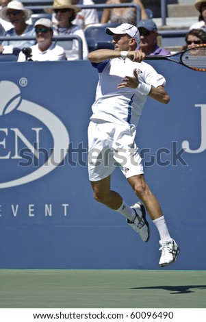 NEW YORK - AUGUST 30: Nikolay Davidenko of Russia returns ball during first round match against Michael Russell of USA at US Open on 28, 2010 in New York City