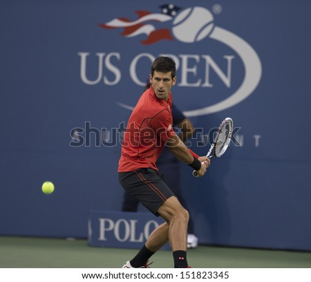 NEW YORK - AUGUST 27: Novak Djokovic of Serbia returns ball during 1st round match against Ricardas Berankis of Lithuania at 2013 US Open at USTA Billie Jean King Tennis Center on Aug 27, 2013 in NYC - stock photo
