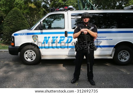 NEW YORK - AUGUST 31, 2015: NYPD counter terrorism officer providing security at National Tennis Center during US Open 2015 in New York  - stock photo