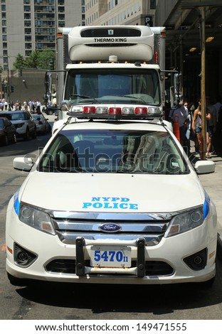 NEW YORK - AUGUST 6: NYPD on high alert after terror threat in New York City on August 6, 2013. Numerous NYPD cars providing security in World Trade Center area of Manhattan