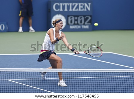 NEW YORK - AUGUST 27: Petra Kvitova of Czech Republic returns ball during 1st round match against Polona Hercog of Slovakia at US Open tennis tournament on August 27, 2012 in Flushing Meadows New York - stock photo