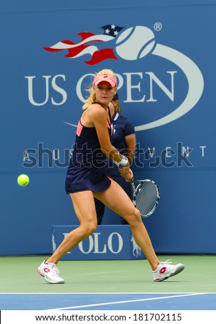 NEW YORK - AUGUST 26: Professional tennis player Agnieszka Radwanska during first round match at US Open 2013 at Billie Jean King National Tennis Center on August 26, 2013 in New York
