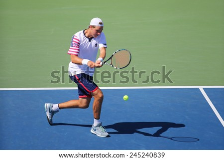 NEW YORK - AUGUST 28, 2014: Professional tennis player Jan-Lennard Struff from Germany during US Open 2014 match against John Isner at Billie Jean King National Tennis Center in New York  - stock photo