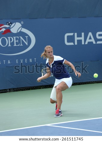 NEW YORK - AUGUST 27, 2013: Professional tennis player Lesia Tsurenko from Ukraine during US Open 2013 match against Lusie Safarova at Billie Jean King National Tennis Center - stock photo