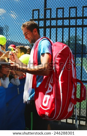 NEW YORK - AUGUST 28, 2014 Professional tennis player Marin Cilic signing autographs after practice for US Open 2014 at Billie Jean King National Tennis Center in New York  - stock photo