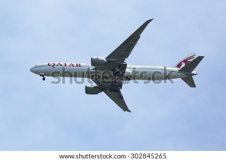 NEW YORK - AUGUST 2, 2015: Qatar  Airways Boeing 777 descending for landing at JFK International Airport in New York. Qatar Airways is the state-owned flag carrier of Qatar - stock photo