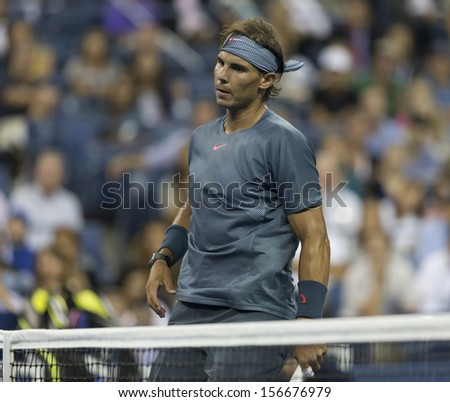 NEW YORK - AUGUST 29: Rafael Nadal of Spain reacts during 2nd round match against Rogerio Dutra Silva of Brazil at 2013 US Open at USTA Billie Jean King Tennis Center on August 29, 2013 in New York - stock photo
