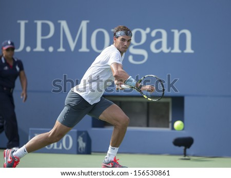 NEW YORK - AUGUST 31: Rafael Nadal of Spain returns ball during 3rd round match against Ivan Dodig of Chroatia at 2013 US Open at USTA Billie Jean King Tennis Center on August 31, 2013 in New York - stock photo