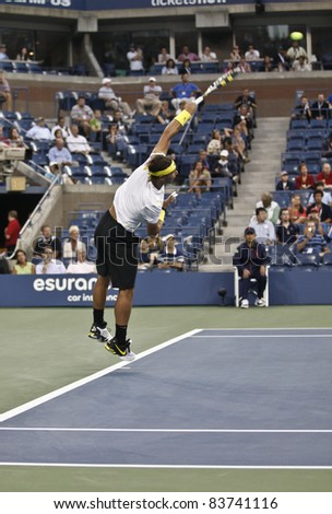 NEW YORK - AUGUST 30: Rafael Nadal  returns ball during 1st round match against Rafael Nadal of Spain at USTA Billie Jean King National Tennis Center on August 30, 2011 in New York City - stock photo