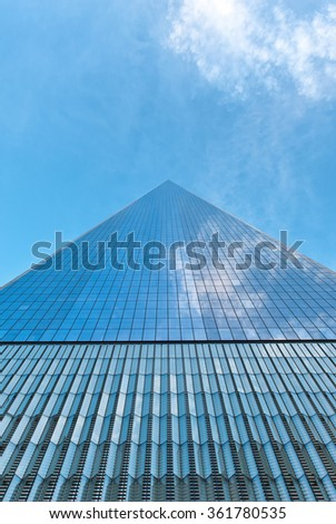NEW YORK - AUGUST 27: Receding perspective looking up from below of the glass facade of the new One World Trade Center. August 27, 2015 in New York.