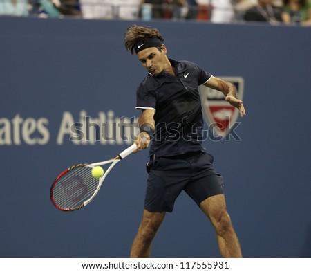 NEW YORK - AUGUST 27: Roger Federer of Switzerland returns ball during 1st round match against Donald Young of USA at US Open tennis tournament on August 27, 2012 in Flushing Meadows New York - stock photo