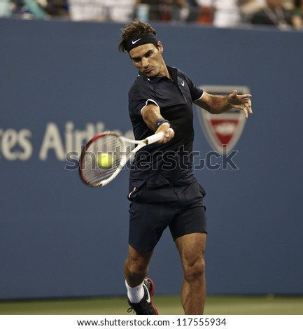 NEW YORK - AUGUST 27: Roger Federer of Switzerland returns ball during 1st round match against Donald Young of USA at US Open tennis tournament on August 27, 2012 in Flushing Meadows New York