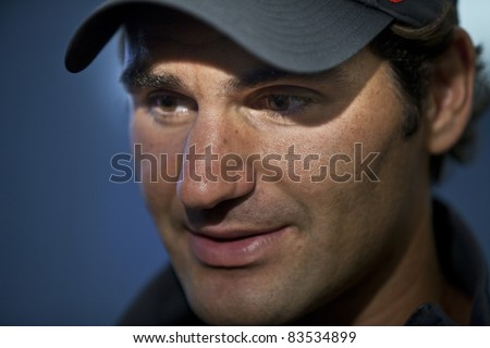 NEW YORK - AUGUST 27: Roger Federer of Switzerland talks to the media during previews at USTA Billie Jean King National Tennis Center on August 27, 2011 in New York City, NY. - stock photo