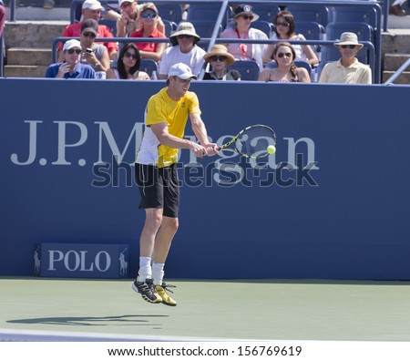 NEW YORK - AUGUST 27: Sam Querrey of USA returns ball during 1st round match against Guido Pella of Argentina at 2013 US Open at USTA Billie Jean King Tennis Center on August 27, 2013 in NYC