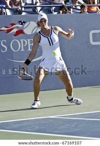 NEW YORK - AUGUST 30: Samantha Stosur of Australia returns ball during match against Elena Vesnina of Russia at US Open tennis tournament on August 30, 2010, New York.