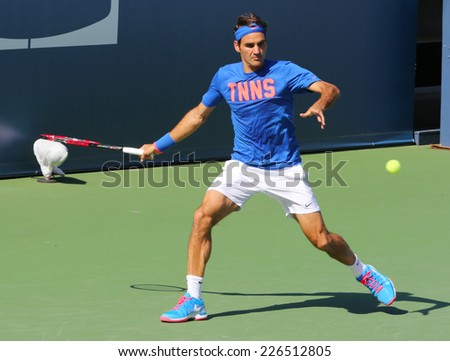 NEW YORK - AUGUST 24: Seventeen times Grand Slam champion Roger Federer practices for US Open 2014 at Billie Jean King National Tennis Center on August 24 , 2014 in New York - stock photo