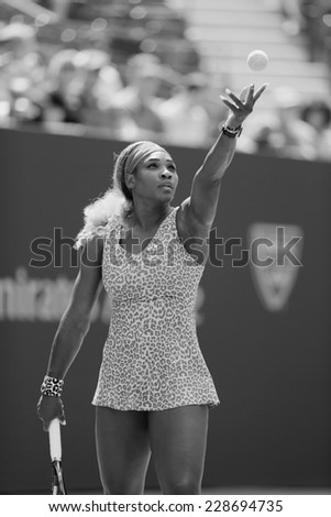 NEW YORK - AUGUST 28 Seventeen times Grand Slam champion Serena Williams serving during match at US Open 2014 at Billie Jean King National Tennis Center on August 28, 2014 in NY  - stock photo