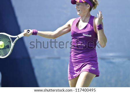 NEW YORK - AUGUST 28: Shahar Peer of Israel returns ball during 1st round match against Lara Arruabarrena-Vecino of Spain at US Open tennis tournament on August 28, 2012 in Flushing Meadows New York