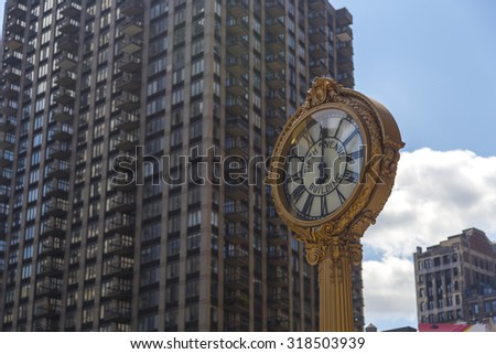 NEW YORK - AUGUST 30, 2014: Sidewalk clock at 200 Fifth Avenue (1909) with Flatiron building facade on June, 28th 2012 in NY. - stock photo