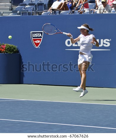 NEW YORK - AUGUST 31: Simona Halep of Romania returns a ball during match against Jelena Jankovic of Serbia at US Open tennis tournament on August 31, 2010, New York.