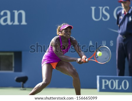 NEW YORK - AUGUST 30: Sloan Stephens of USA returns ball during 3rd round match against Jamie Hampton of USA at 2013 US Open at USTA Billie Jean King Tennis Center on August 30, 2013 in New York