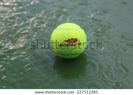 NEW YORK - AUGUST 31: Tennis ball at rain delay during US Open 2014 at Arthur Ashe Stadium at Billie Jean King National Tennis Center on August 31, 2014 in Flushing, NY - stock photo