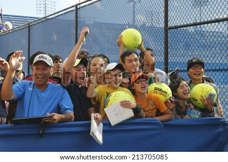 NEW YORK - AUGUST 24: Tennis fans waiting for autographs at Billie Jean King National Tennis Center on August 24, 2014 in New York. US Open is a final Grand Slam tournament of the year  - stock photo