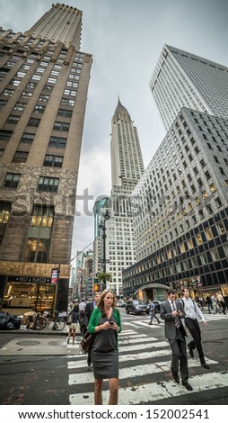 NEW YORK - AUGUST 20: The Chrysler Building on August 20, 2013 in New York. The Chrysler Building is an Art Deco style skyscraper in New York City, on the east side of Manhattan. - stock photo