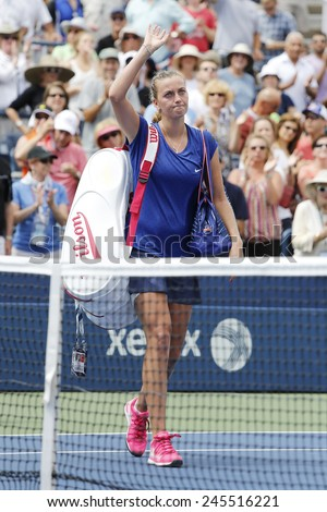 NEW YORK- AUGUST 30, 2104: Two times Grand Slam champion Petra Kvitova leaving court after loss at US Open 2014 round 3 match against Aleksandra Krunic at Billie Jean King National Tennis Center  - stock photo