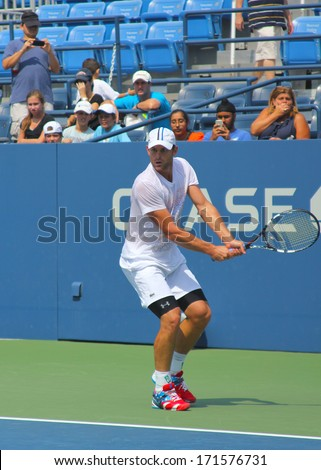 NEW YORK - AUGUST 25: US Open champion Andy Roddick practices for US Open at Louis Armstrong Stadium at Billie Jean King National Tennis Center on August 25, 2012 in New York - stock photo