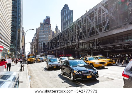 NEW YORK - AUGUST 22: View to the 8th Av from W42nd Street in New York on August 22, 2015. Its in the district of West Midtown, New York. - stock photo