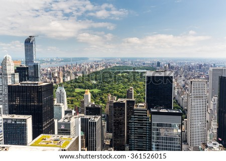 NEW YORK - AUGUST 23: View to Uptown Manhattan with the famous Central Park on August 23, 2015. This view is from the rooftop of an another skyscraper. - stock photo