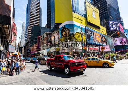 NEW YORK - AUGUST 22: Views of the rush streets of Manhattan at Times Square on August 22, 2015. Times Square is a busy place in the Midtown district of Manhattan, New York.  - stock photo