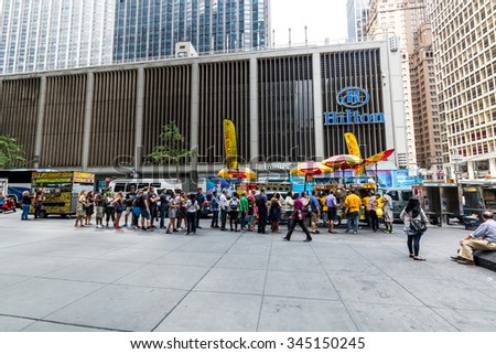 NEW YORK - AUGUST 23: Views to the fast food stands at the Fifth Avenue, New York on August 23, 2015. Fast food stands are very popular in Manhattan New York. - stock photo